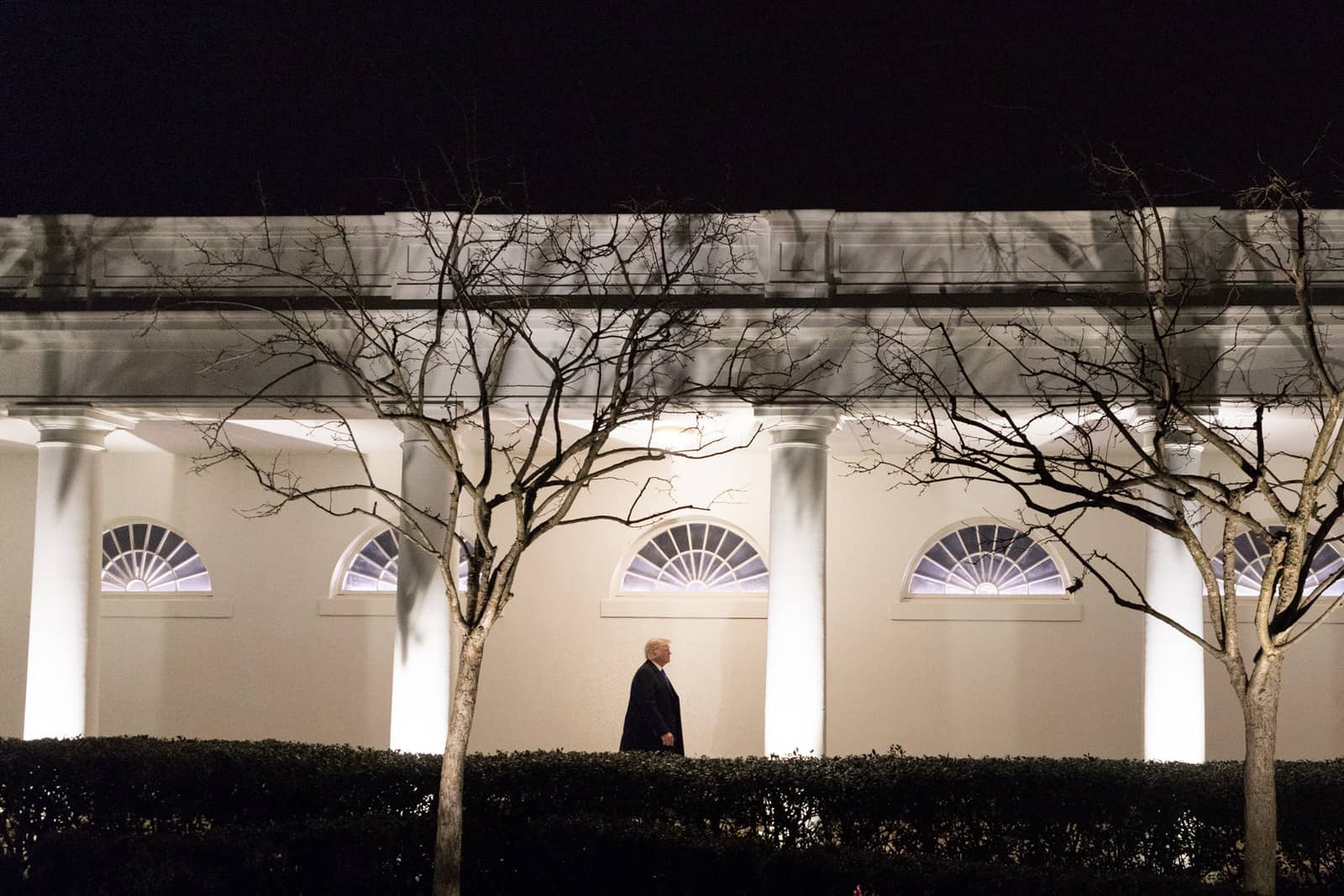 trump walks at the white house