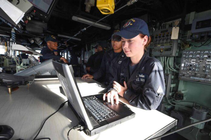 navy quartermaster with computer on USS ashland
