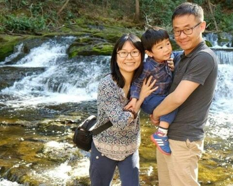 Xiyue Wang with his wife and son