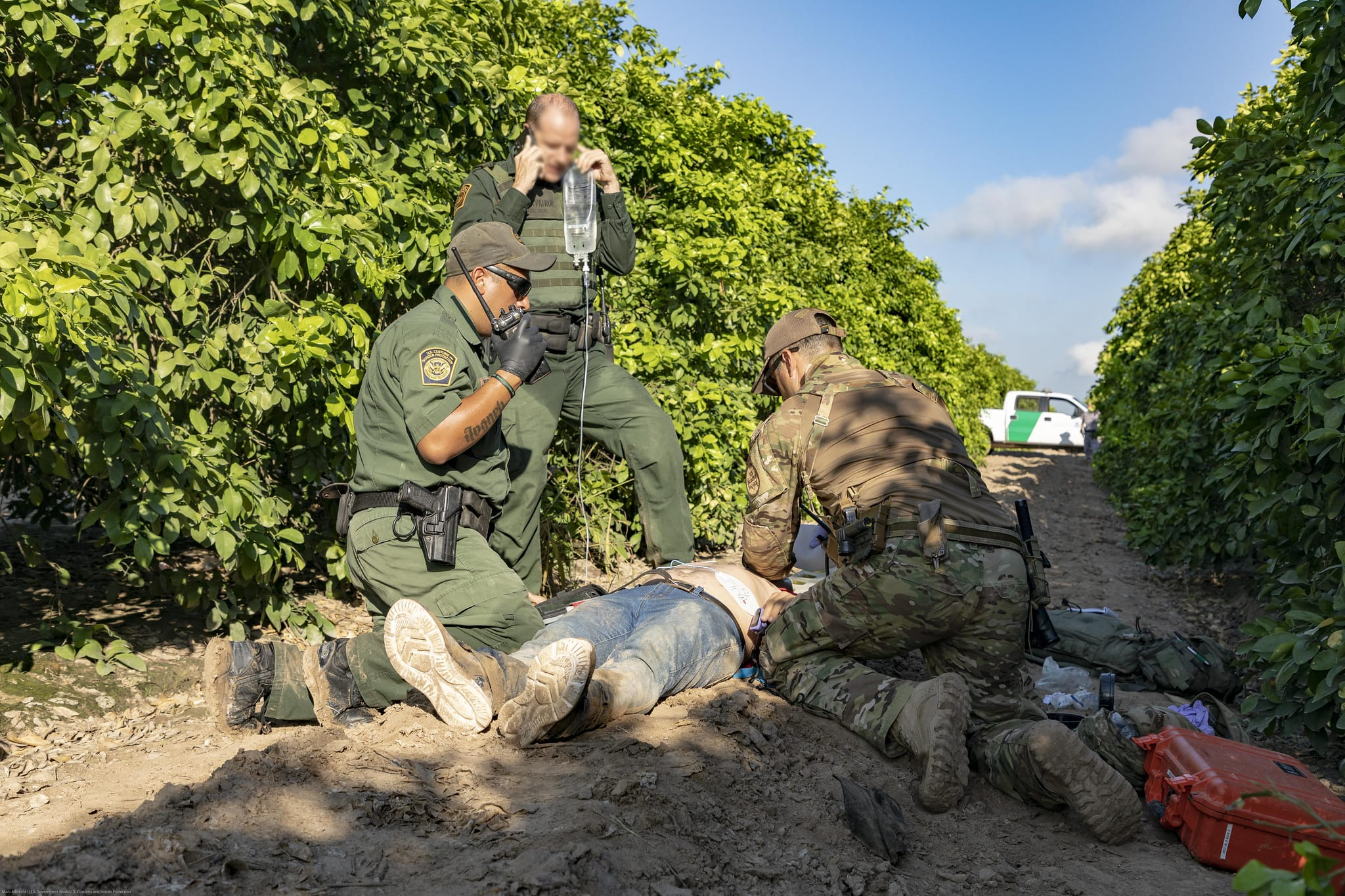 U.S. Border Patrol agents give medical aid to a Mexican national