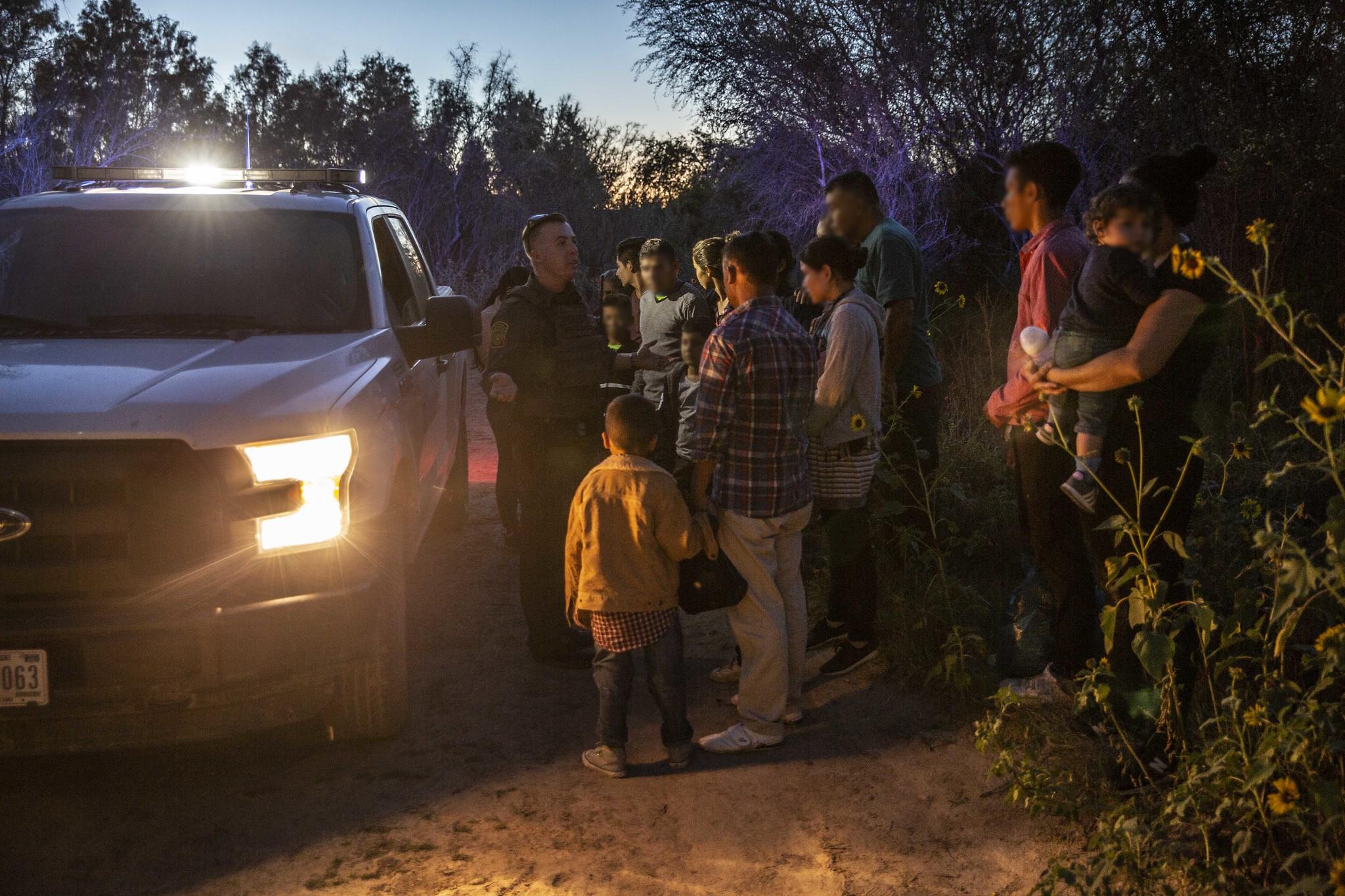 migrants near Los Ebanos, Texas